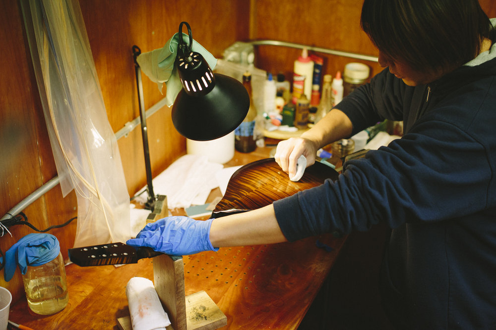 Kosuke Kyomori french polishing a Model M in the Marshall Workshop.
