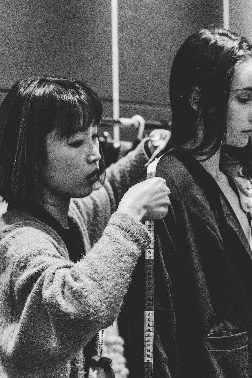 Designer making final measurements to her garments during final fittings. TPFF, Hana Photography, 2017