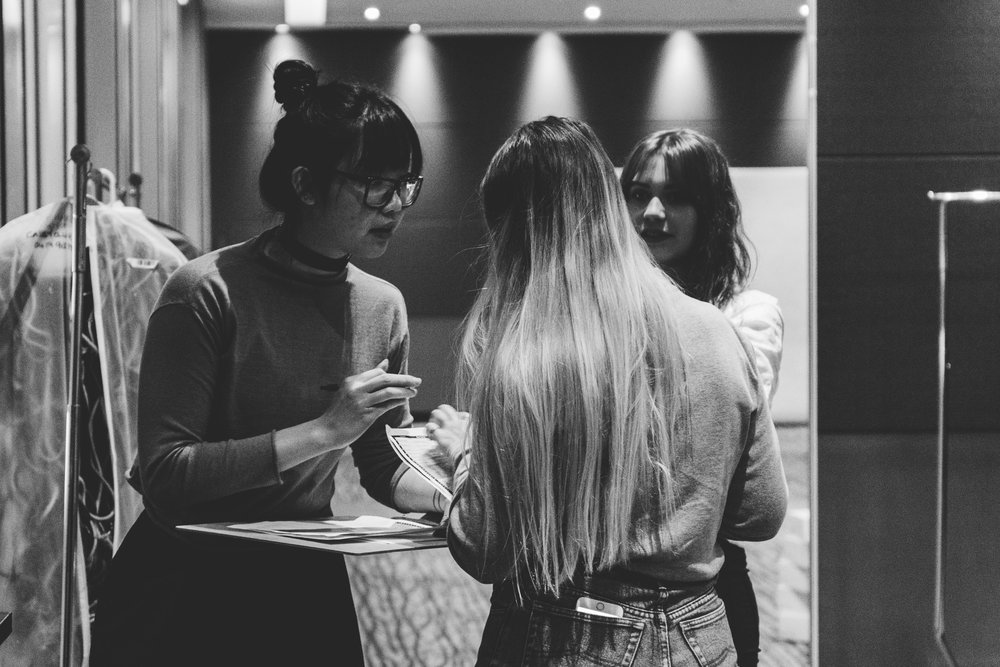 Kim checking details with her team. TPFF, Hana Photography, 2017.