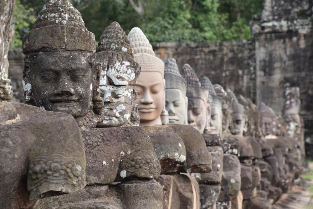 Statues of the gods guarding the entrance to Angkor Thom
