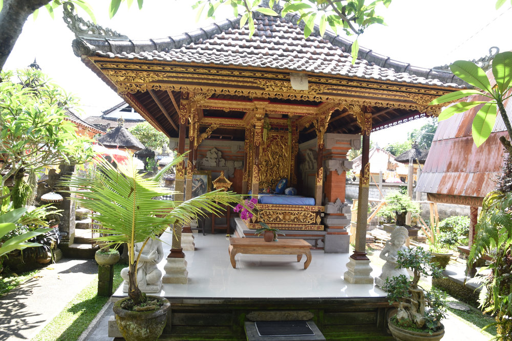 a local family's family compound with many altars and shrines