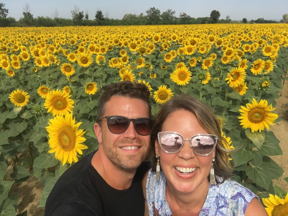 Derek & I dancing through sunflower fields on our trip around the world...thanks to our families and friends who encouraged us to do it!