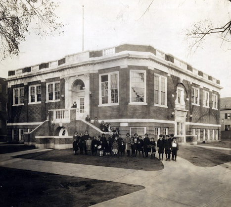 Children stand in front of the Dixwell Avenue Branch Library