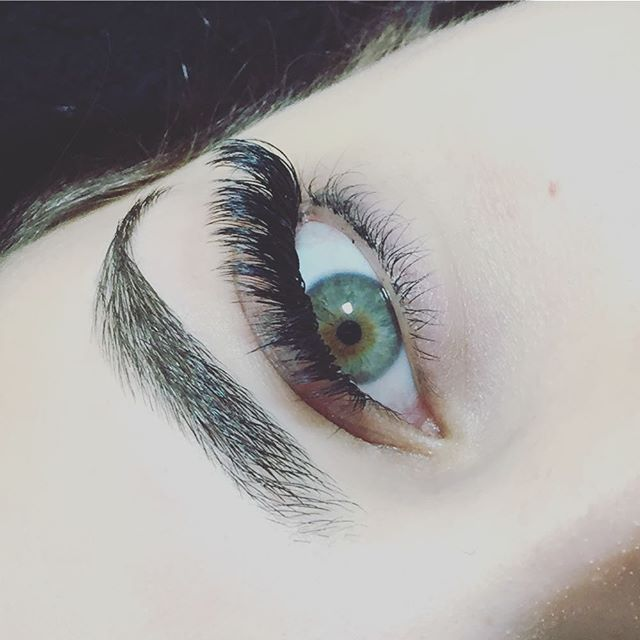 A gorgeous green with a dark black lash