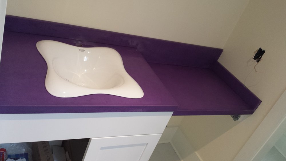 greyrock_concrete_bathroom_vanity_countertops_purple.jpg