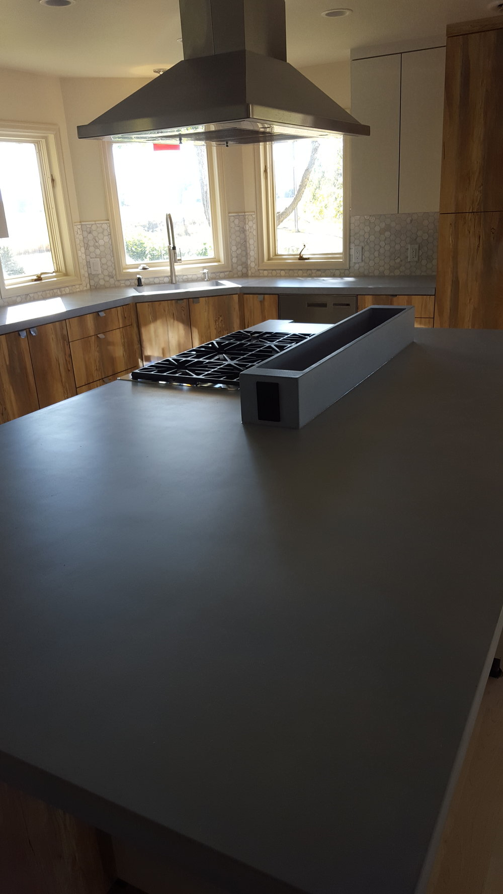 greyrockconcrete_customcountertops_grey_kitchen_concrete_countertops_customconcretecolorado_customisland_island_concreteisland_greyrock.jpg