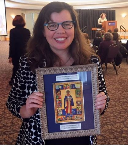 Syneva Barrett pictured with her 2017 Sr. Amata Miller Catholic Mission in Action award