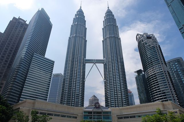 🇲🇾 ⠀ The Petronas Twin Towers are definitely the most iconic buildings in Malaysia, and it was impressive to see them in person! I had a great time in Kuala Lumpur and really enjoyed walking around the city and learning more about its unique history. Read more about my time in Malaysia at the link in my bio.⠀ Country 108/195⠀ .⠀⠀ .⠀⠀ .⠀⠀ .⠀⠀ .⠀⠀ #trekwithtaylor #travelgram #womentravel #tripstagram #worldtraveler #travelblog #bucketlistlife #travelgirl #femaletravelbloggers #travelinsta #trip #worldnomads #adventuretravel #worldtrip #explorer #explore #traveltheworld #getaway #travelphotos #travelpics #globetrotter #lifewelltraveled #trips #passportready #worldtravel #wander #PetronasTwinTowers #KualaLumpur #Malaysia