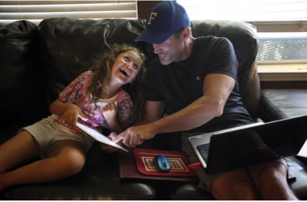 Jeff Hensley of Frisco takes a break from his homework with daughter Kacey, 8. The Navy and Air Force veteran is using the GI Bill to pursue a master's degree in mental health counseling at the University of North Texas.