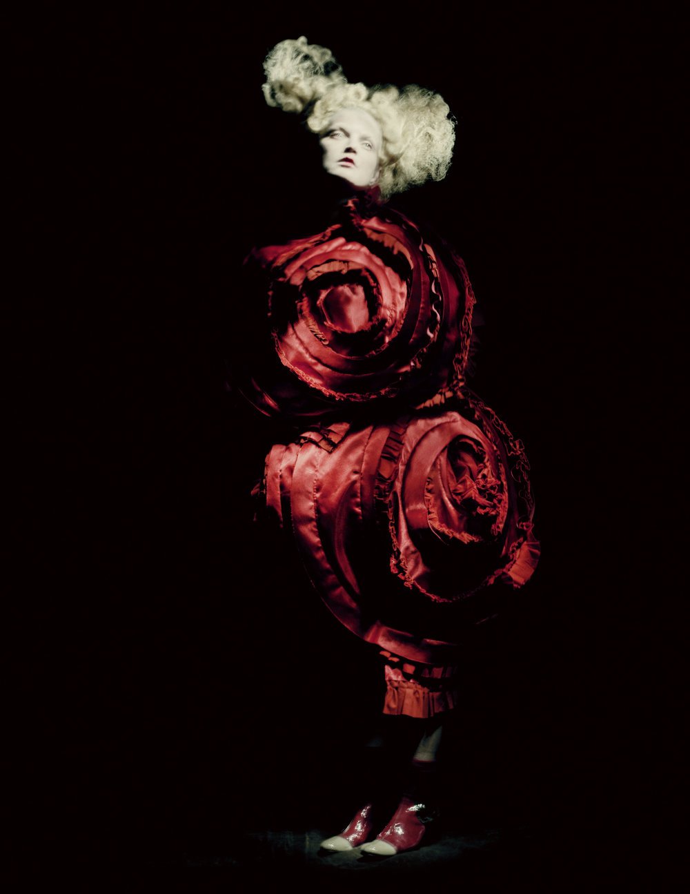 Rei Kawakubo (Japanese, born 1942) for Comme des Garçons  (Japanese, founded 1969), Blood and Roses, spring/summer  2015; Courtesy of Comme des Garçons.  Photograph by © Paolo Roversi; Courtesy of The Metropolitan  Museum of Art
