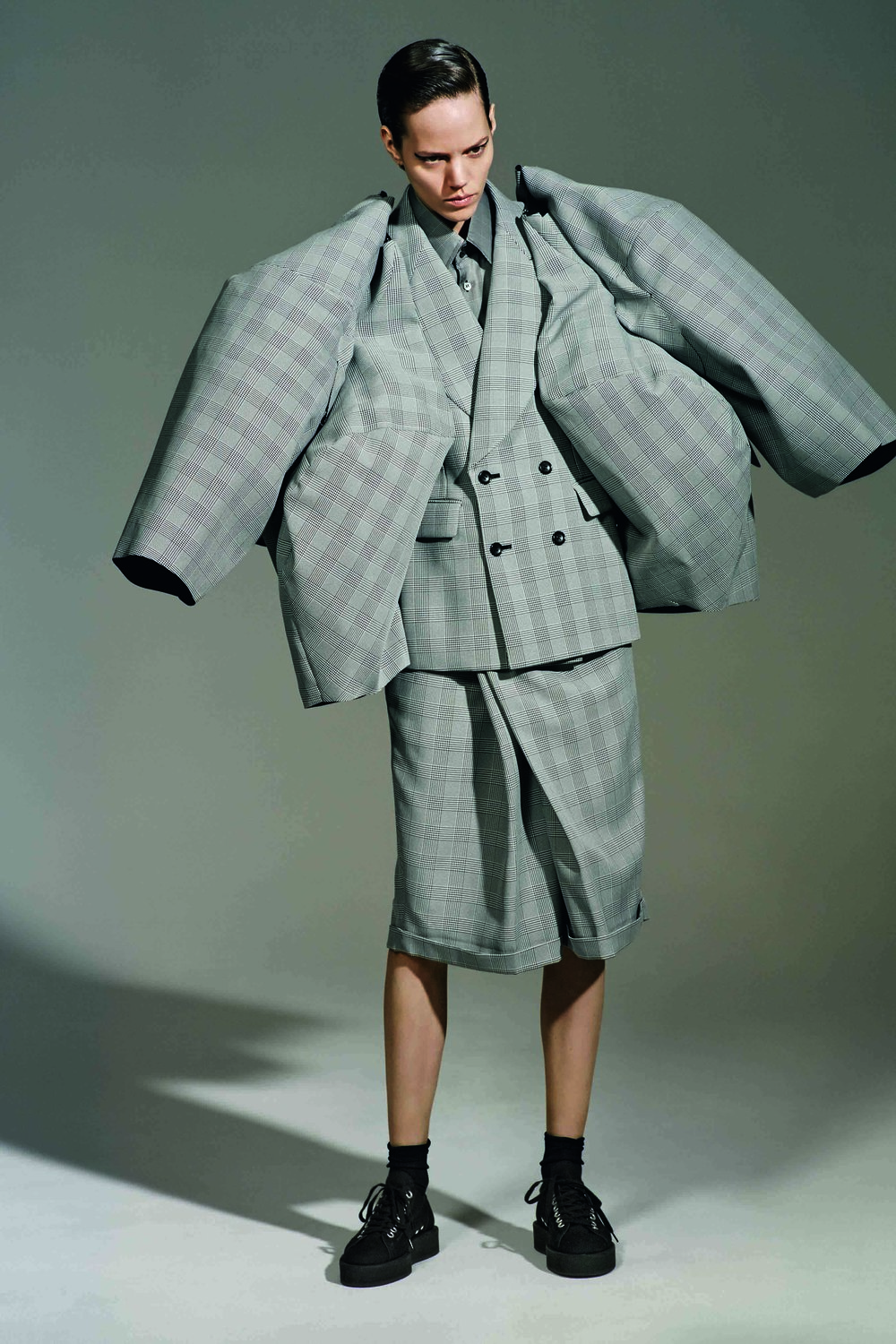 Rei Kawakubo (Japanese, born 1942) for Comme des Garçons  (Japanese, founded 1969), The Infinity of Tailoring,  autumn/winter 2013–14; Courtesy of Comme des Garçons.  Photograph by © Collier Schorr; Courtesy of The Metropolitan  Museum of Art