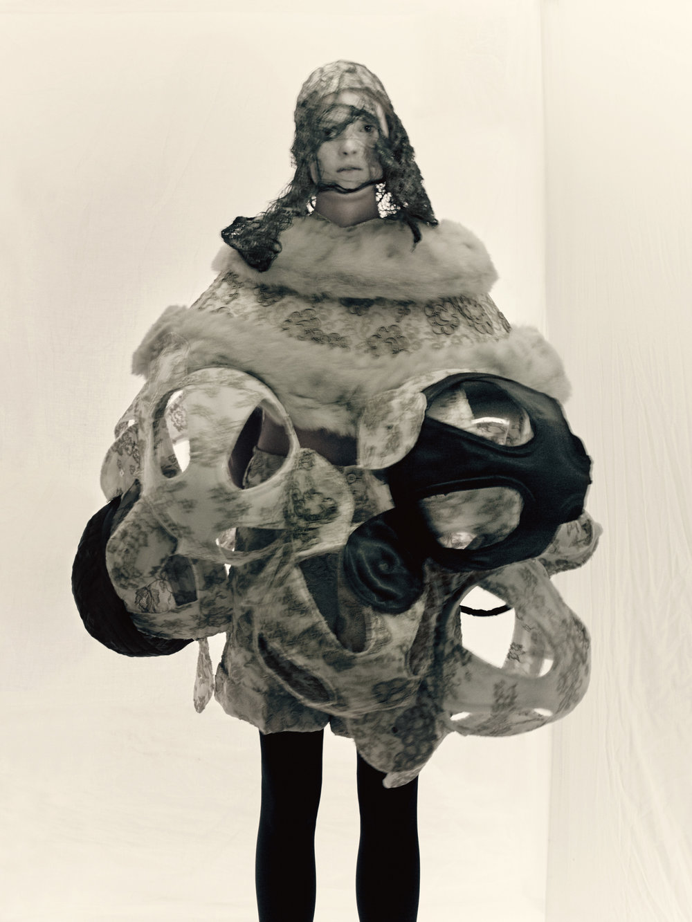 Rei Kawakubo (Japanese, born 1942) for Comme des Garçons  (Japanese, founded 1969). Ceremony of Separation,  autumn/winter 2015–2016.  Photograph by © Paolo Roversi; Courtesy of The Metropolitan  Museum of Art
