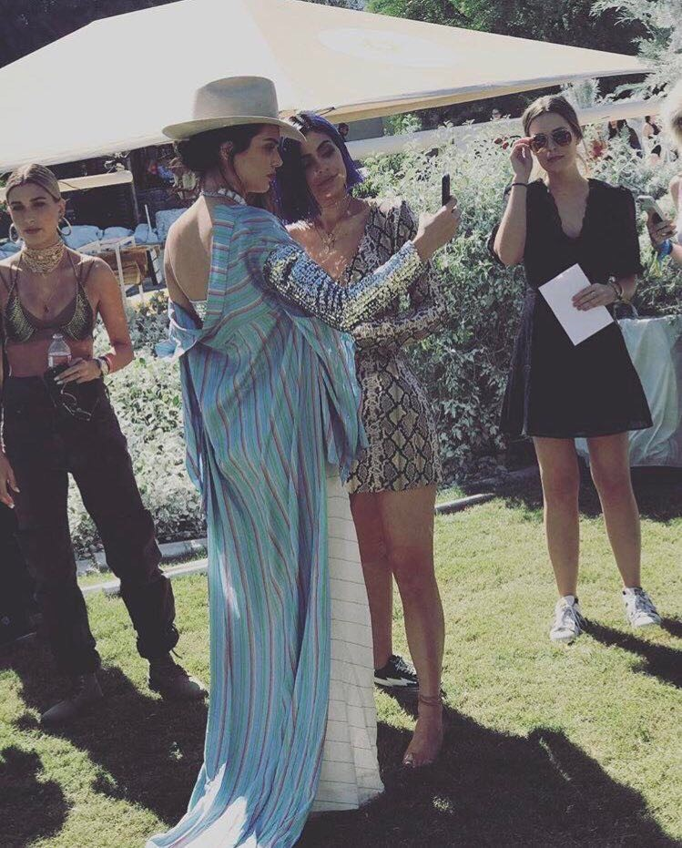 Kendal Jenner, wearing a total look from designer Esteban Cortazar,  with her sister Kylie at Coachella.