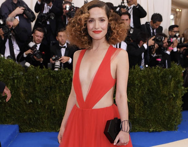 Actress Rose Byrne arrived at the Met Gala on Monday wearing a red Ralph Lauren dress and striking Dauphin jewelry.