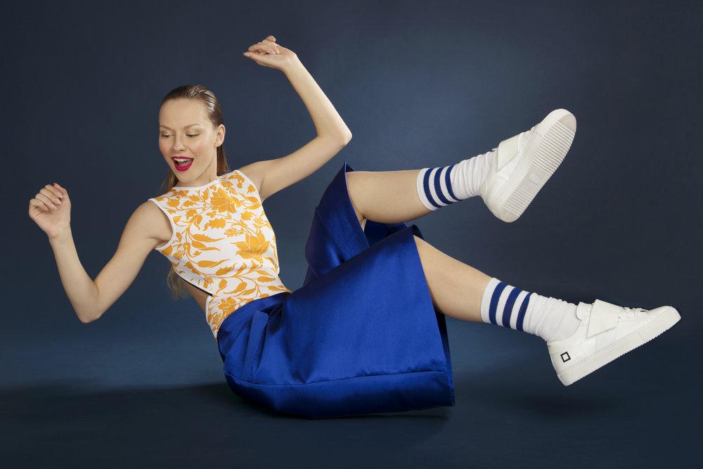 Body orange & white: MRZ Blue short trousers: Giovanna Nicolai White shoes: D.a.t.e