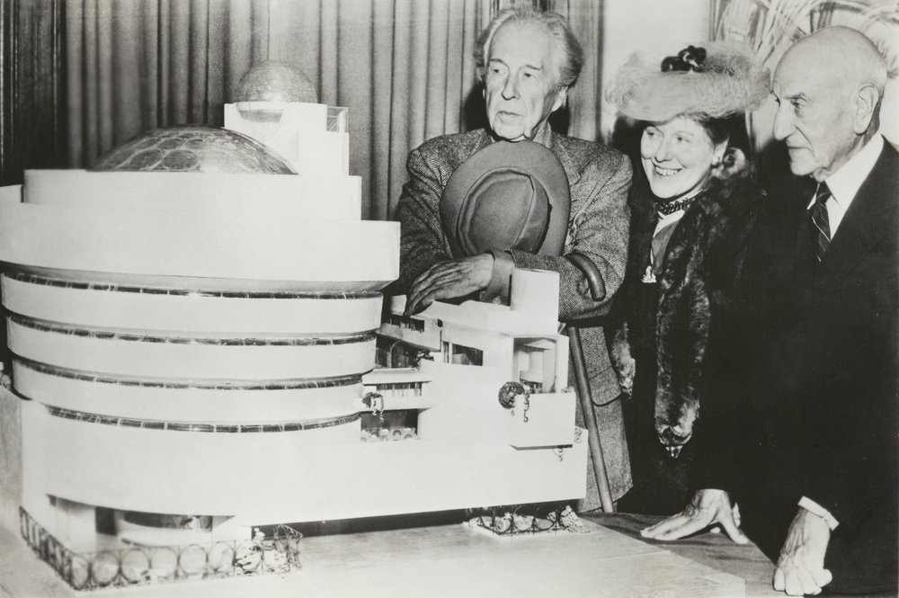 Frank Lloyd Wright, Hilla Rebay, and Solomon R. Guggenheim with a model of the building. Solomon R. Guggenheim Museum Archives. New York, NY