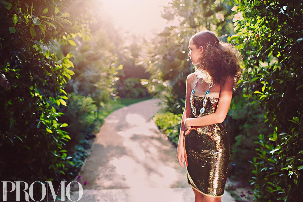 Dress - Dolce & Gabbana  Necklace - Prada  Earrings - Sarah Magid