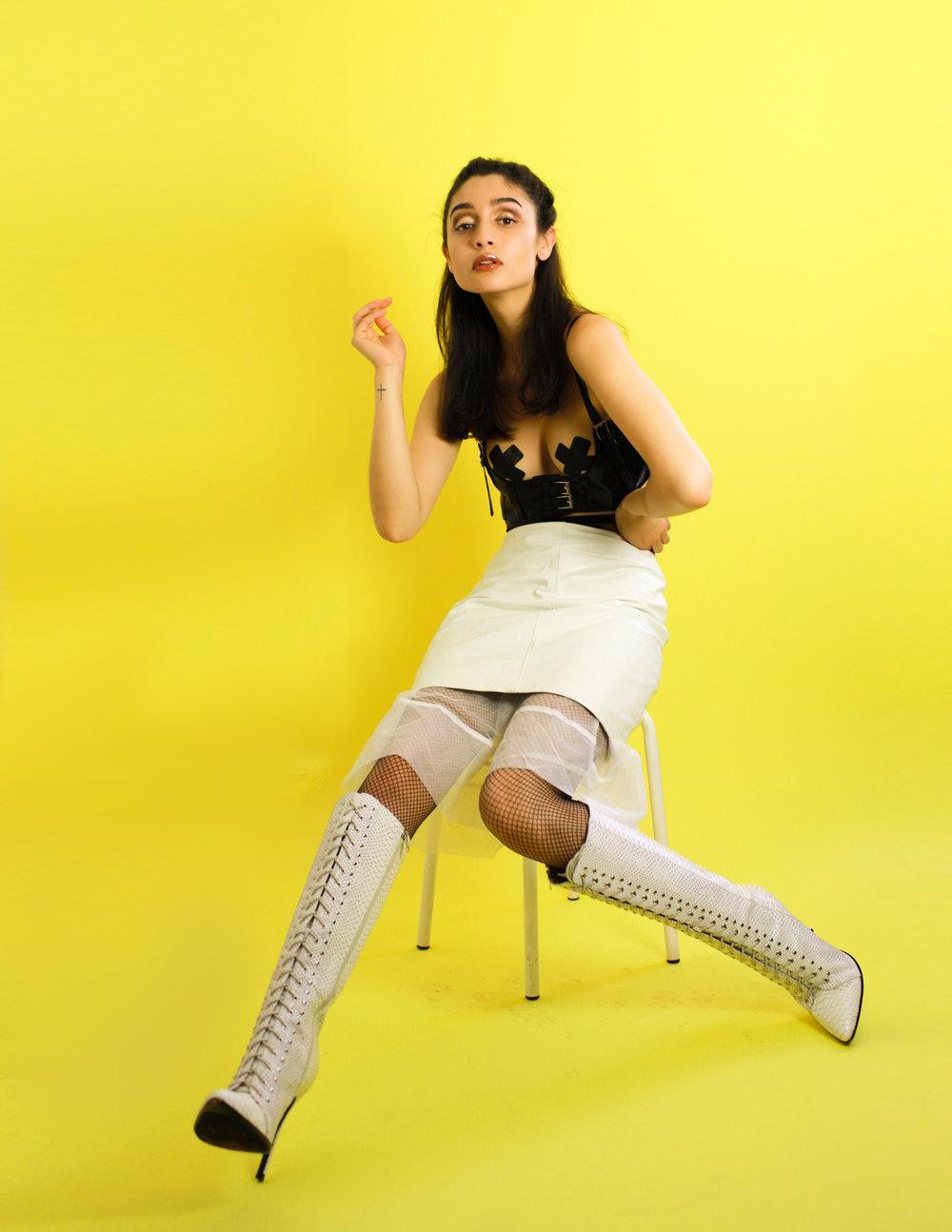 Bra - Seductions  Skirt- Grandeur  Boots - Tejahn