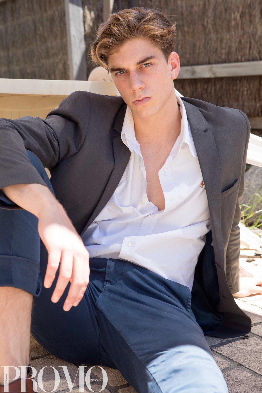 White long sleeve collard shirt: Ralph Lauren Brown Leather boots: Politix  Blue long pants: Industrie