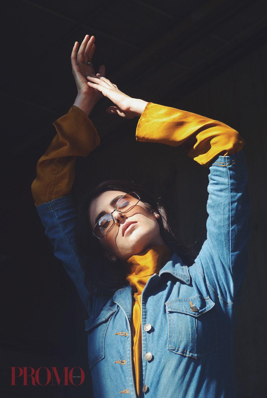Mustard Top: Aissata Levi Ibrahim  Jean Jumpsuit: Stylists Own  Sunglasses: Stylists Own  Shoes: Ellesse