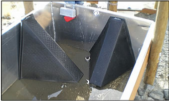 escape ramp installed in aluminum water trough