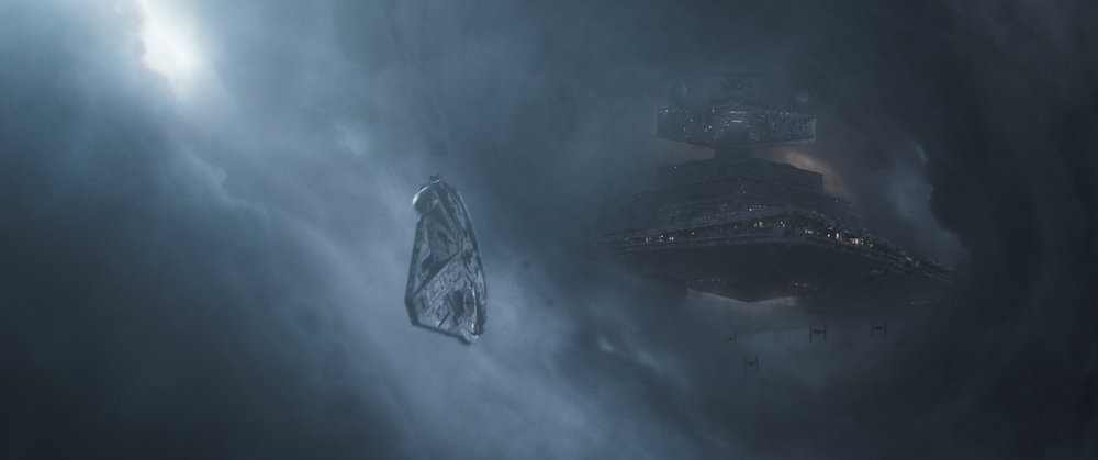 "The  Millennium Falcon  veering away from an Imperial starship along the famed ""Kessel run"" in  Solo: A Star Wars Story"
