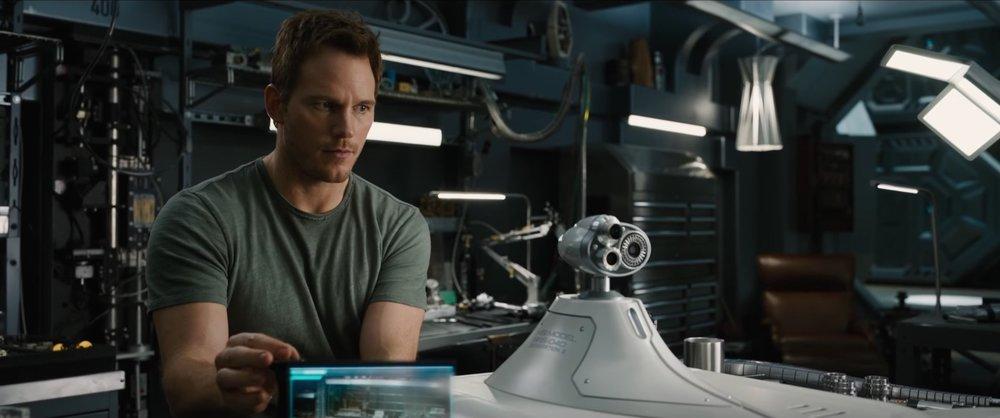 Chris Pratt modifying a robot aboard  Avalon  in  Passengers