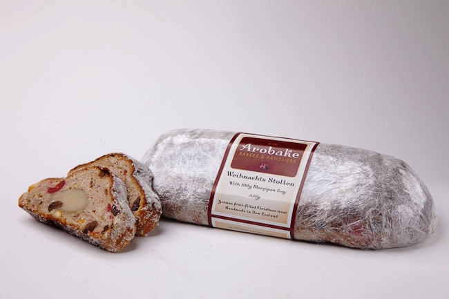 Weihnachts Stollen - A rich yeast-risen cake, this rum steeped, fruit filled wonder is immersed in melted butter before we roll it in sugar. It's Christmas, indulge yourself. $23.50
