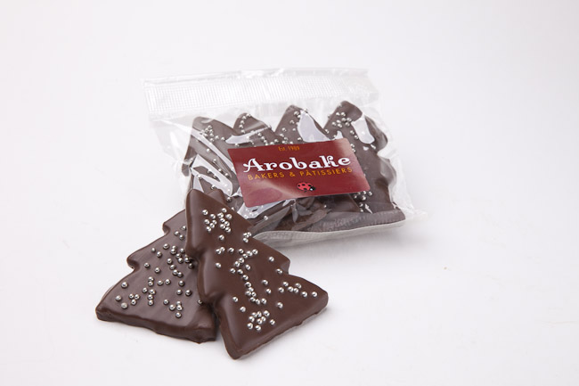 Chocolate Christmas trees - Chocolate shortbread, chocolate topped Christmas trees 5 per pack. $7.90