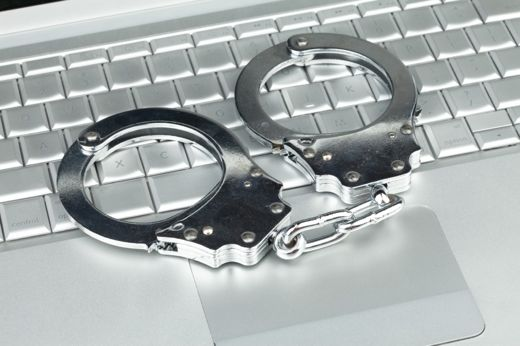 online crime with handcuffs