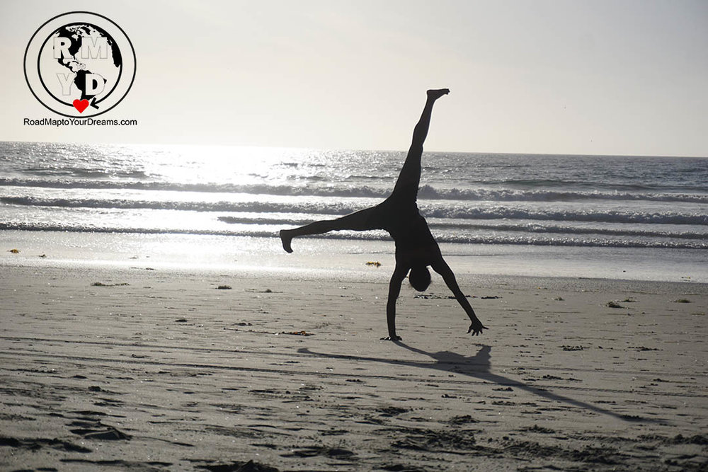 Making moments count.  Autumn McKenzie Jackson cartwheeling on the beach!  Why not?