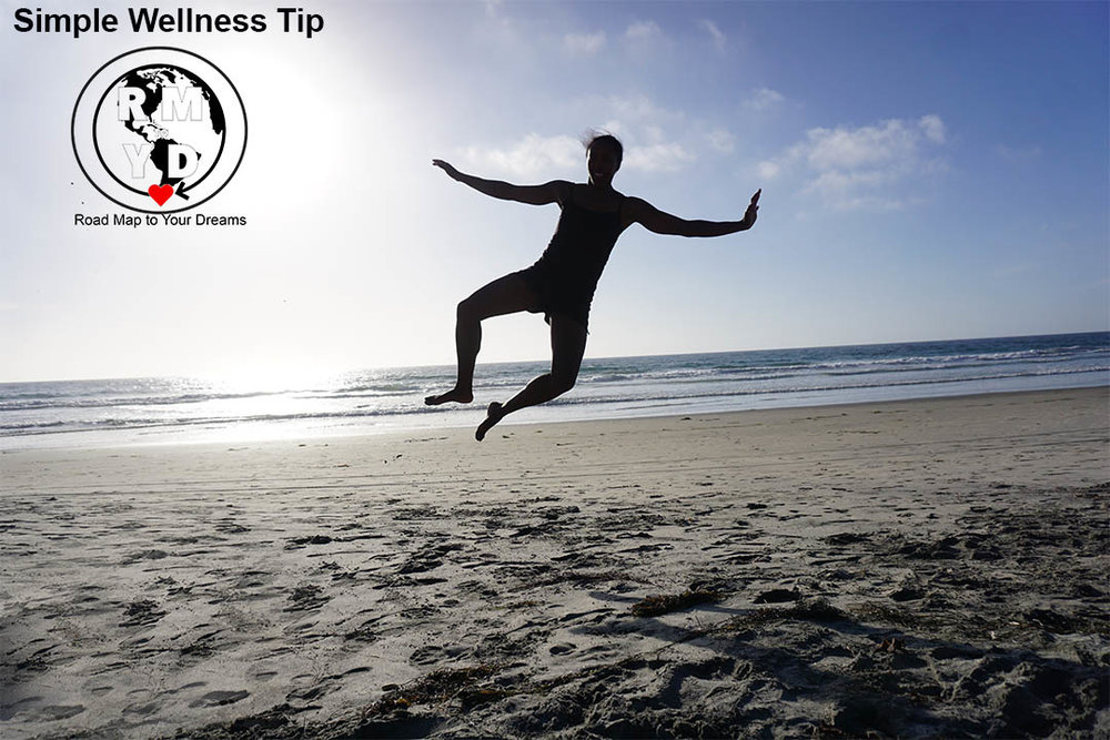 Autumn jumping and clicking my heels on a beach in Southern California.