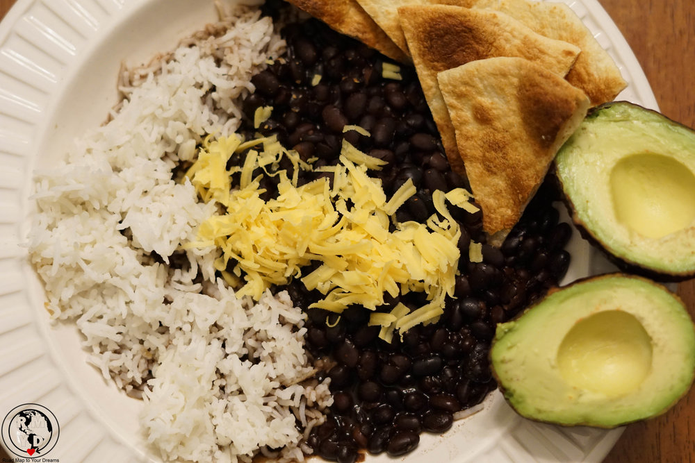 Black beans, rice, cheese, avocado! Beans prepared in slow cooker.