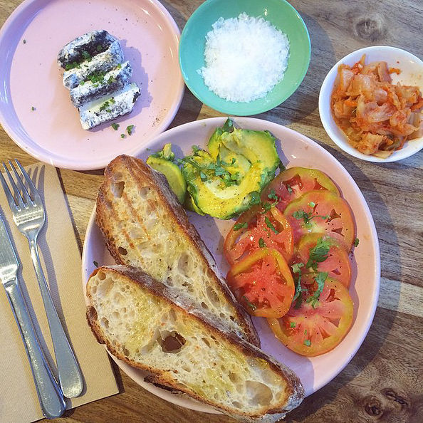 Pictured: Avo, tomato with toast served with goats cheese and kimchi