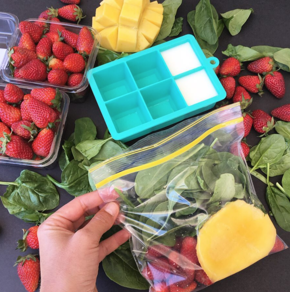 Smoothie packs ready to go into the freezer. I bought baby spinach, mangoes, strawberries in bulk + I freeze milk in ice-cube trays for thicker smoothies.