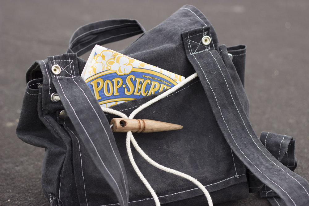 Secure - Keep your Pop Secret Top Secret with the hidden pocket against your back. The Quick-Cinch strap is also secured against your back to thwart any would-be bag bandits.