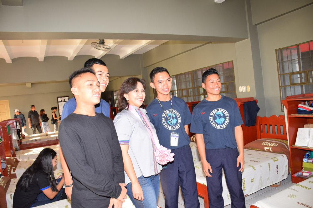 Vice-President Leni Robredo inspects the sleeping quarters with residents from her home province of Bicol.