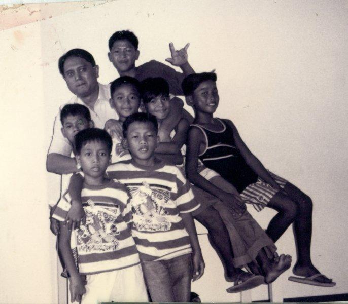1993 - Fr Rocky and Kids.jpg