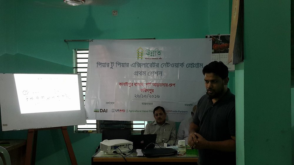 M. Saifur Rahman explains how a P2PAN Network works. This session was hosted for a group of jute traders from Kanaipur Bazar, Faridpur.