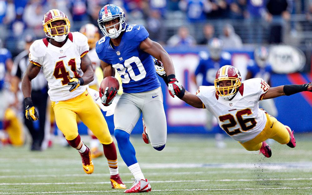 Victor Cruz breaks through Redskins' defense. Photo/NYGiantsrush.com