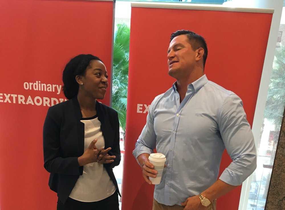 Bianca Marley speaking with Superbowl Champ and former NY Giant punter, Steve Weatherford.