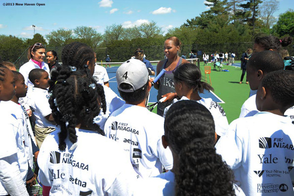 Taylor Townsend with kids before the 2013 New Haven Open Tennis Tournament at Yale University in New Haven, Connecticut. Photo by: Bill Weiss/New Haven Open