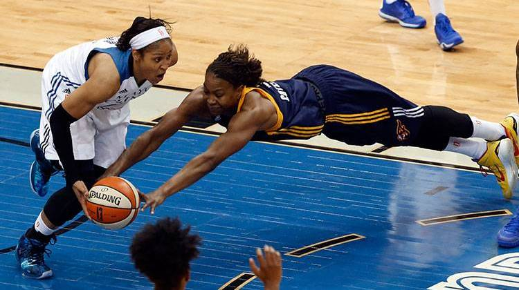 Maya Moore Driving Past Tamika Catchings in 2015 WNBA Championship Series. AP Photo/ Stacy Bengs
