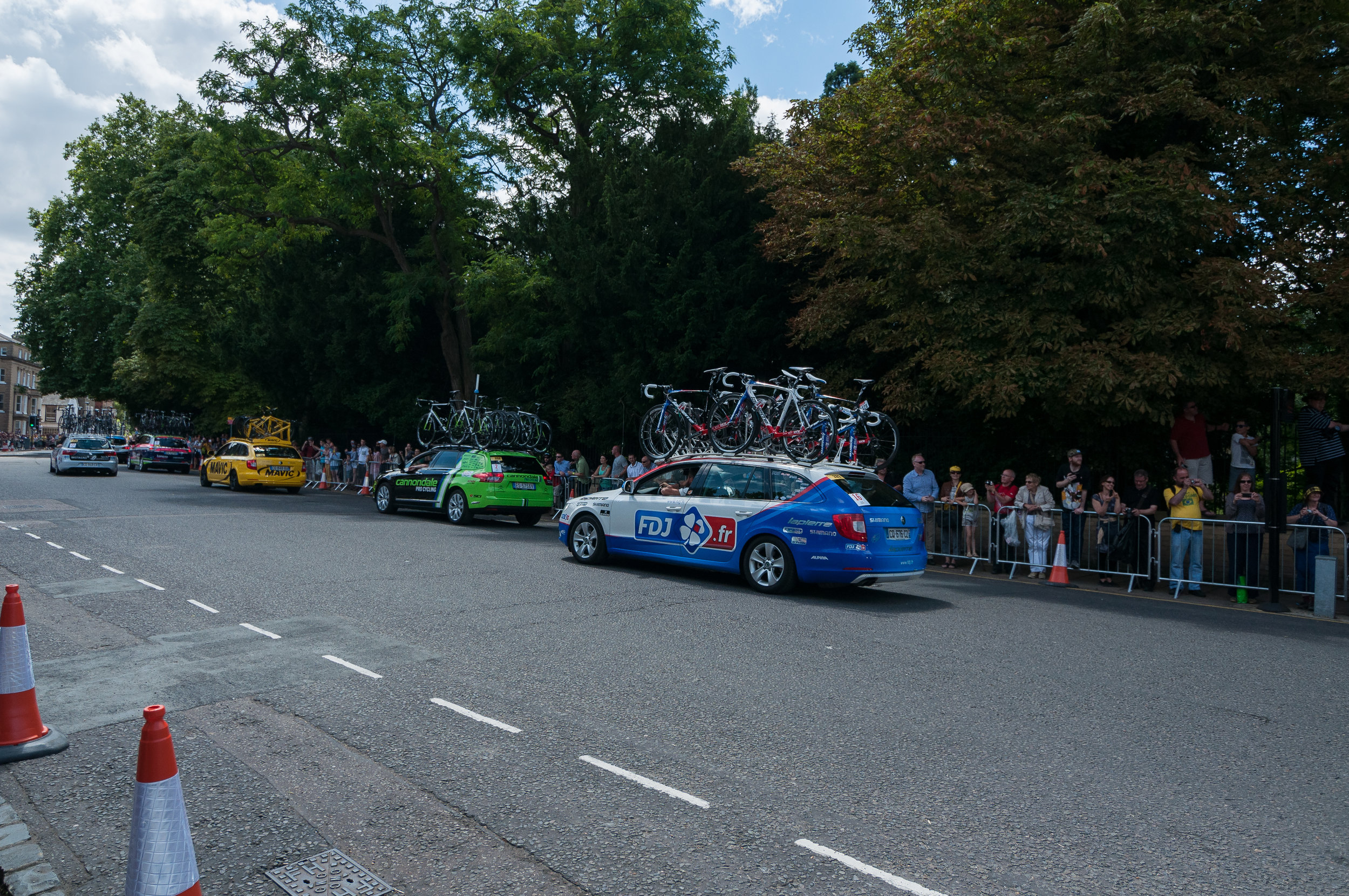 A huge fleet of support cars followed the peloton through. All of them trying to keep close to the cyclists led to a few close calls...