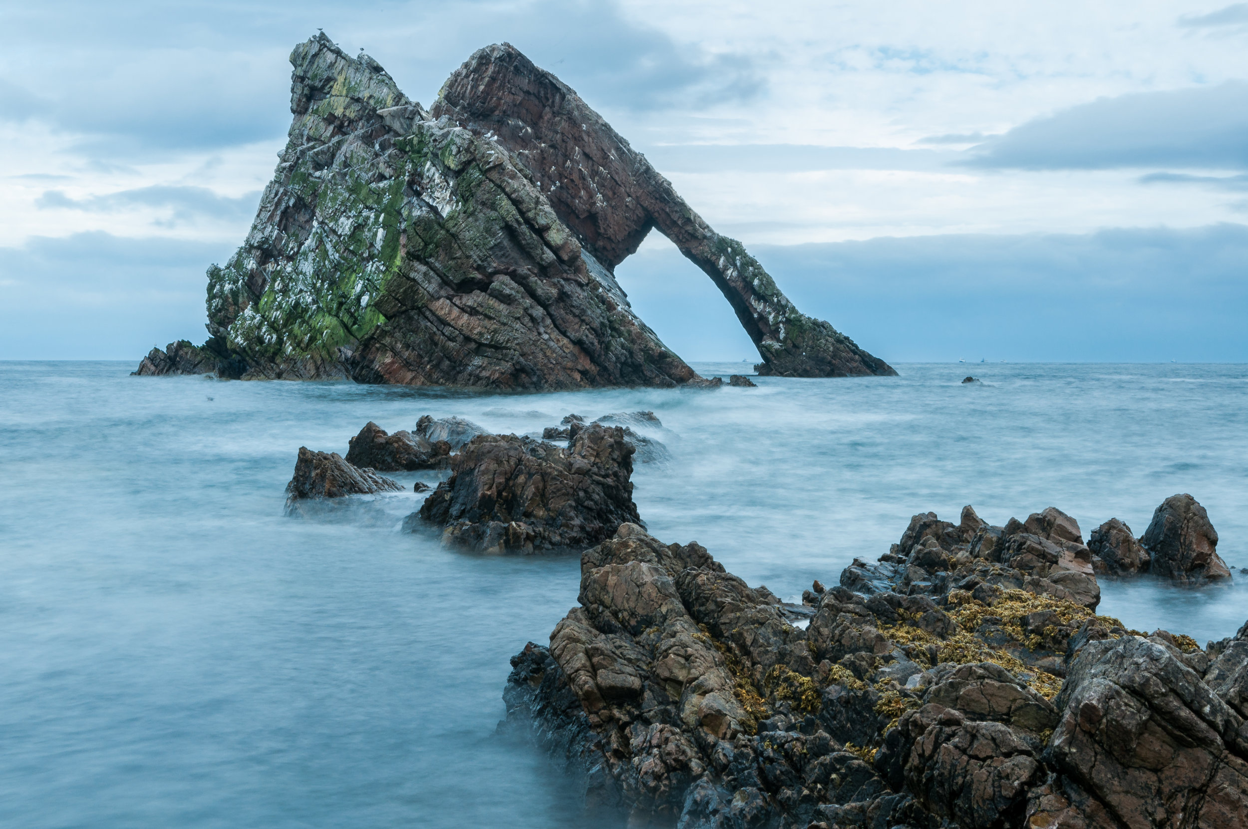 Interesting granite rock formations in Scotland - always seem to be on a slope! This is the Bowfiddle on the north coast; the rocks are beautiful colours (especially with the different flora growing on it).