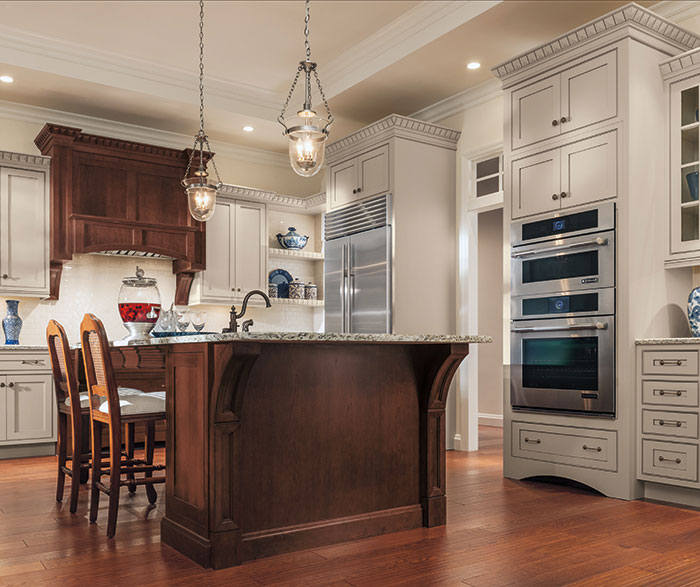 Cherry island and range hood lend an old world elegance to a modern kitchen.