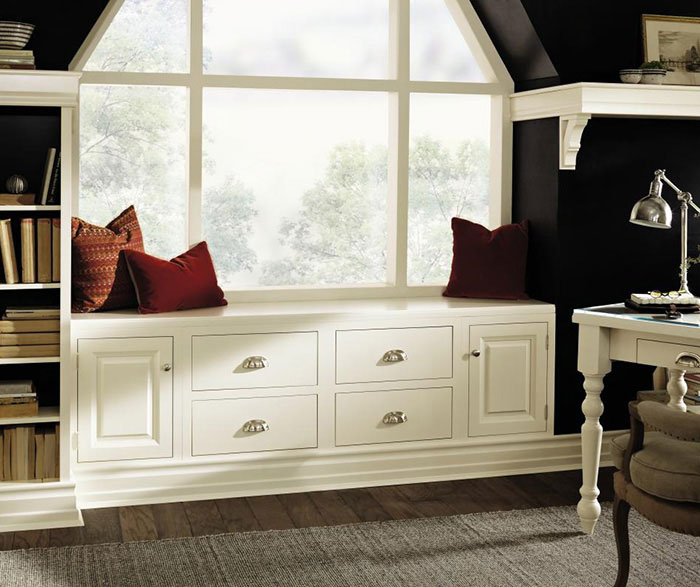 Classic window seats provide storage, seating, and a beautifully framed window.