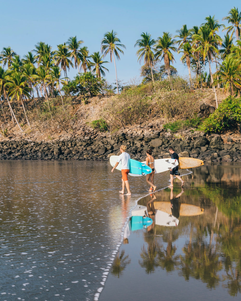 Influencers head out for a morning surf
