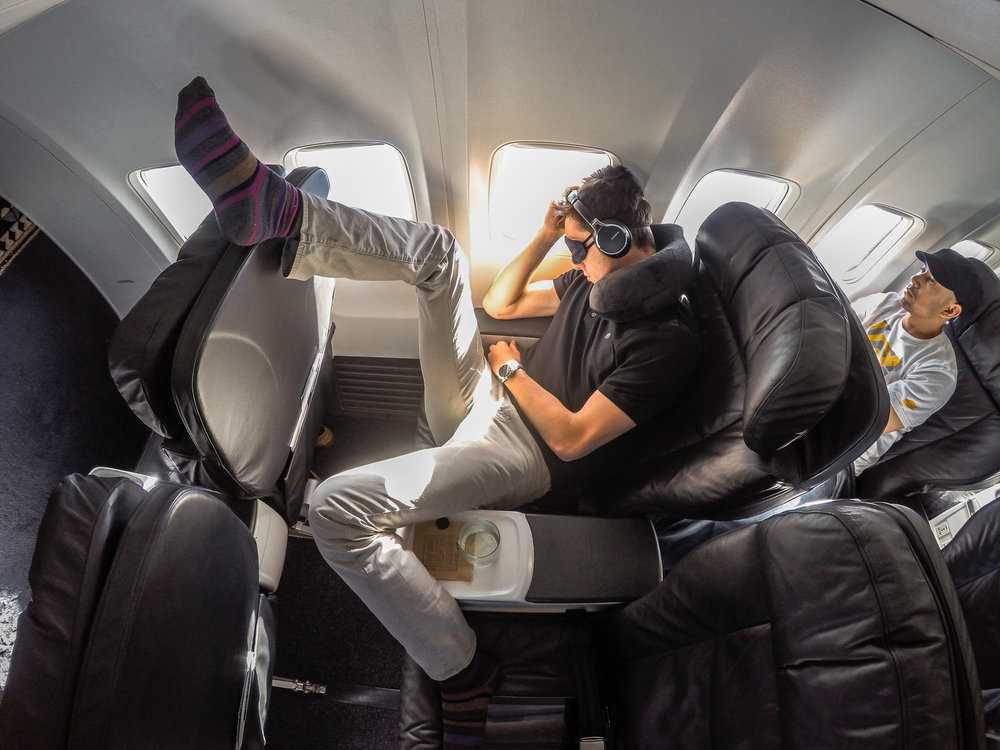 This is not how I actually sleep on planes, this is a joke. No one should ever put their feet on the top of a seat for any reason other than funny instagram photo-ops