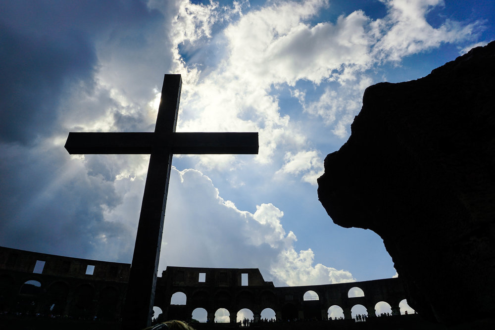 The memorial cross at the entrance of the Colosseum.